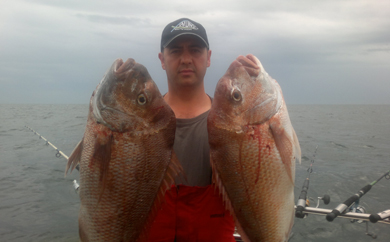 Nick with two snappers over 6kg each caught at the 18th annual snapper Classic