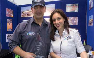 Eleni and Nick displaying the SAV EFF and Innovation Award at the Melbourne Boat Show up close